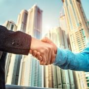 Networking Events Corde Concepts Handshake Handschlag vor Hochhaus Business